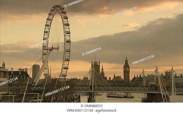 London evening sky with London Eye, Hungerford Bridge, Big Ben and Houses of Parliament