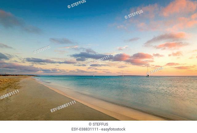 Formentera island famous beach and sailing boats at anchor sunrise seascape