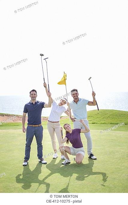 Playful friends on golf course