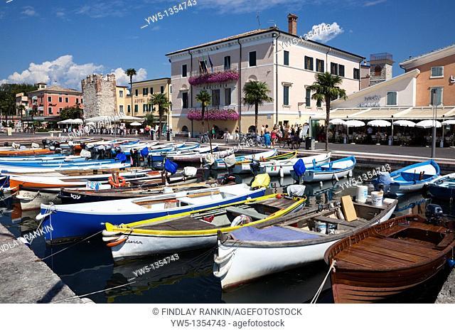 Marina at Bardolino showing the small fishing boats used by local fishermen, Lake Garda, Italy