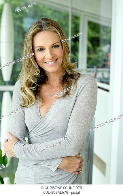 Mature blonde woman smiling, portrait