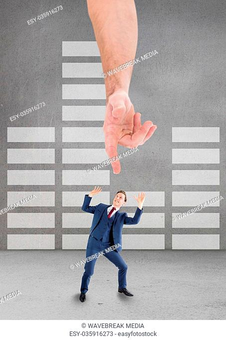 Hand pointing at scared business man against grey background with infographics