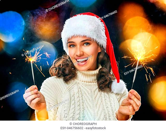 Happy new year! Beautiful woman holding sparkles