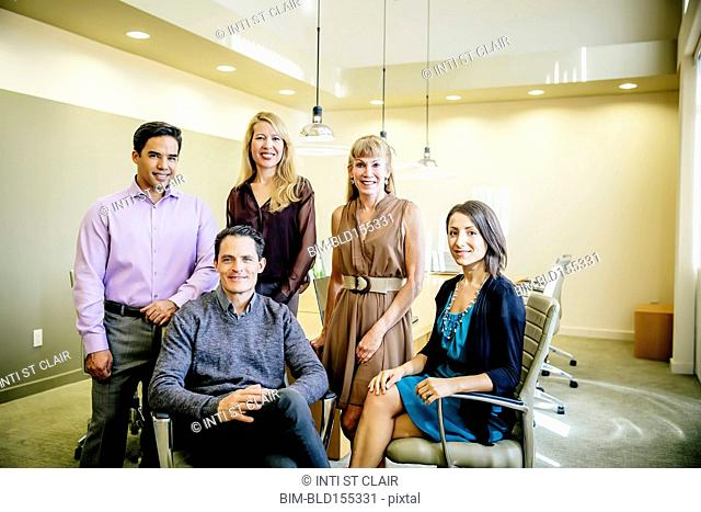 Business people smiling in office meeting