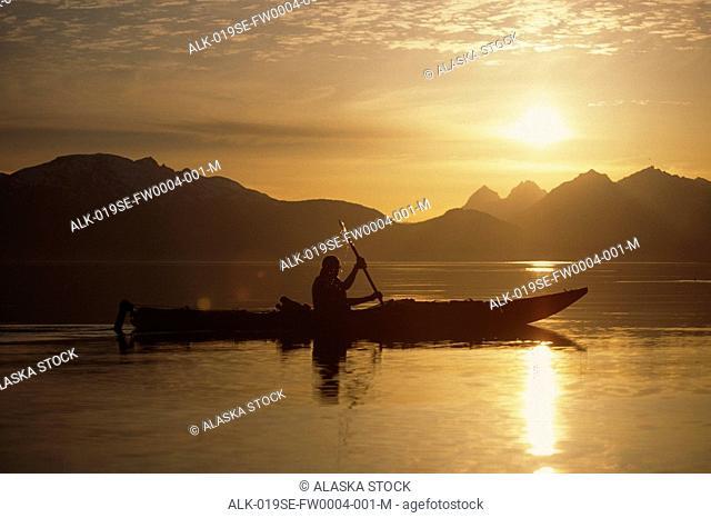 Kayaker Silhouetted Against Sun Inside Passage Lynn Canal Southeast Alaska Summer