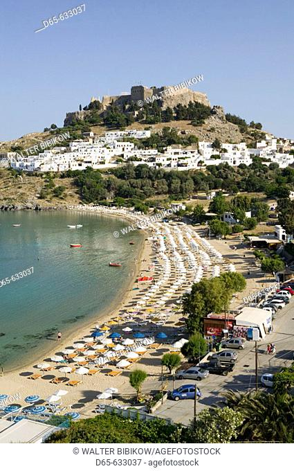Harbor. Beach view with Acropolis of Lindos. Late Afternoon. Lindos. Rhodes. Dodecanese, Greece