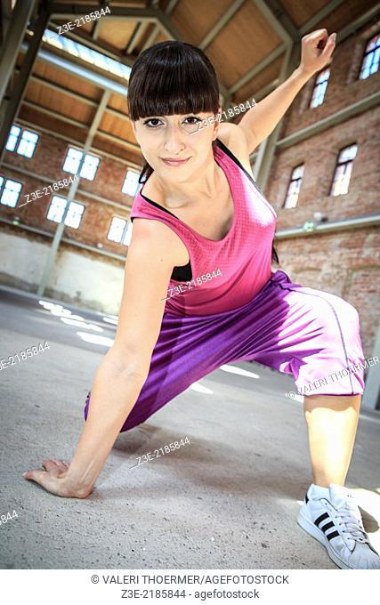 woman in sport dress dancing zumba or aerobics