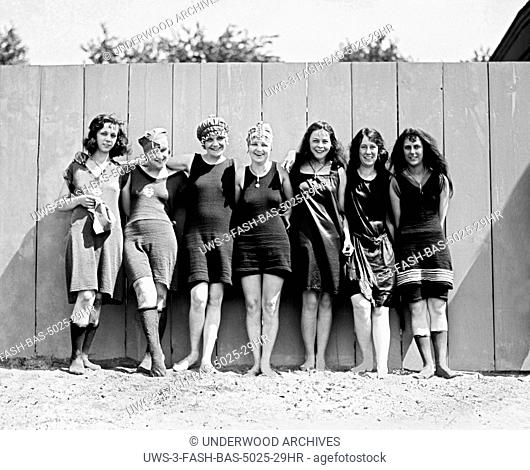 Washington, D.C.: May 29, 1920.Bare legs and scanty one piece bathing suits were very much in evidence at the opening of Washington's municipal bathing beach...