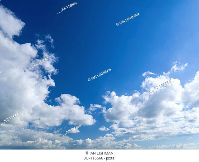 White Clouds Against Blue Summer Sky
