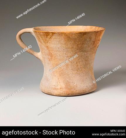Terracotta tankard. Period: Late Minoan III; Date: ca. 1400-1200 B.C; Culture: Minoan; Medium: Terracotta; Plain fine ware; Dimensions: H. 5 9/16 in
