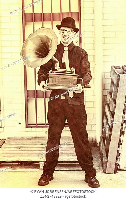 Classical music maestro listening to a gramophone recording in the back alleyway of vintage times. Phonograph portraits