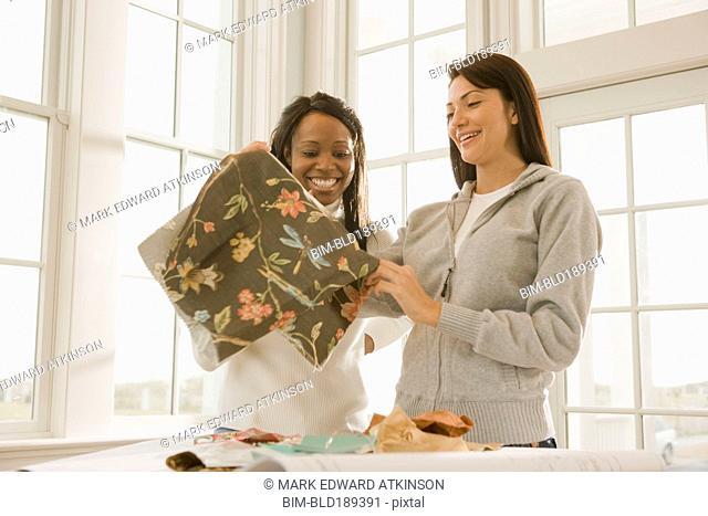 Women holding fabric swatch