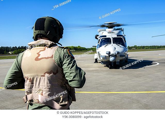 Gilze-Rijen, Netherlands. Air Traffic Controller aiding the crew of an NH90 Marine Chopper with their take of from a military airfield