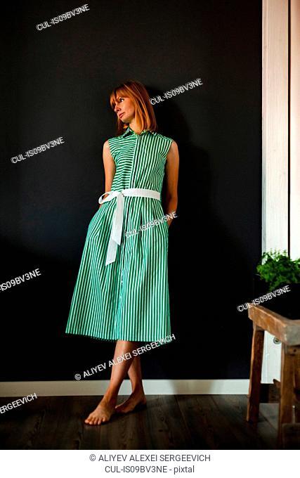 Woman in green summer dress