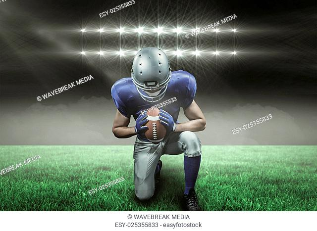 Composite image of american football player kneeling with 3d