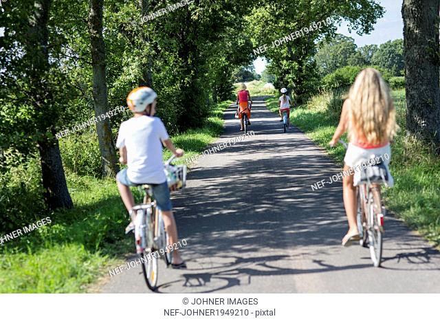 Family cycling, Oland, Sweden