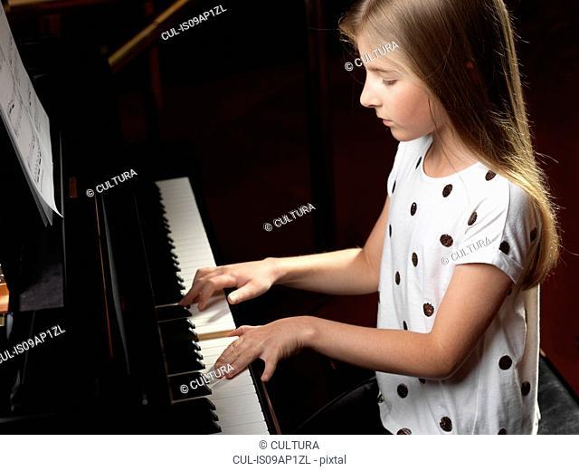 High angle view of girl playing piano
