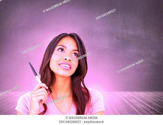 Woman thinking in front of wall with pink glow