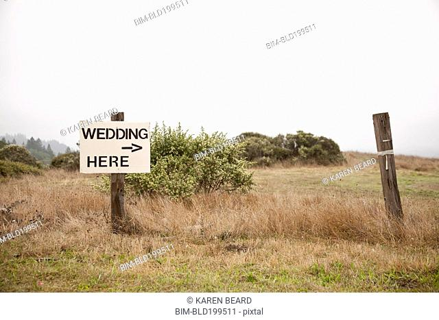 Post in field with sign - Wedding here