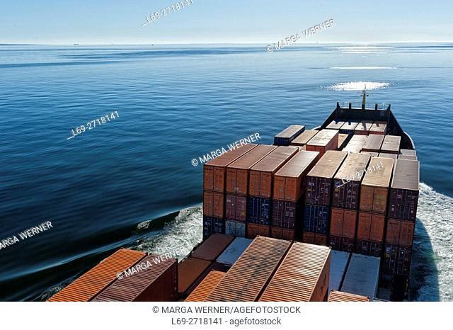 Container vessel crossing the Baltic Sea at sunset, Europe