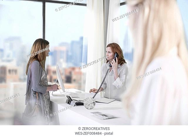 Office receptionist on the phone