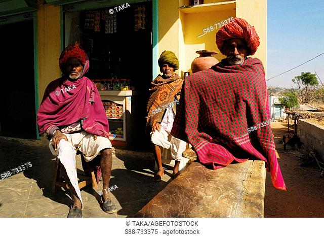 Three Rajasthan men were sitting front of little shop, India