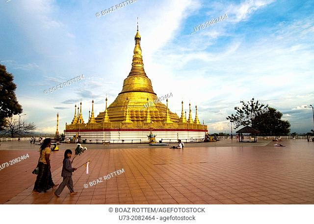 Mother & her son walking towards the Golden Shwadagon pagoda in Tachilek, Myanmar
