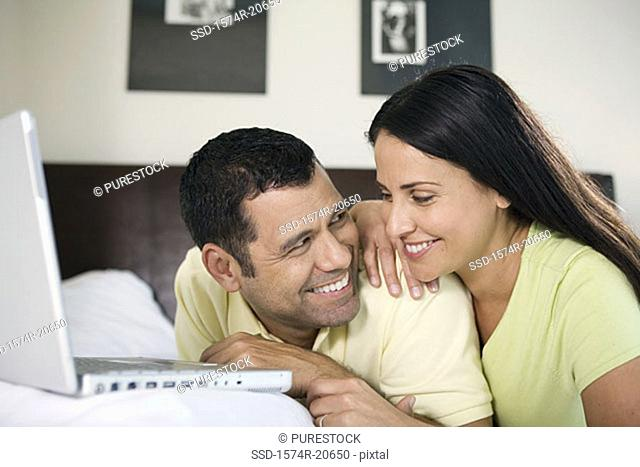 Close-up of a mature couple looking at each other and smiling