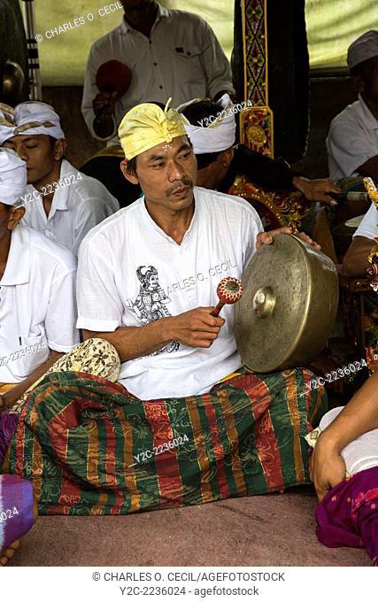 Jatiluwih, Bali, Indonesia. A Gong Player in a Gamelan Orchestra, Luhur Bhujangga Waisnawa Hindu Temple