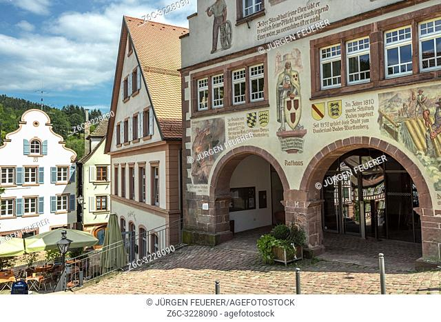 town hall in the historical town Schiltach, Black Forest, Germany, facade with paintings of regional meaning and history