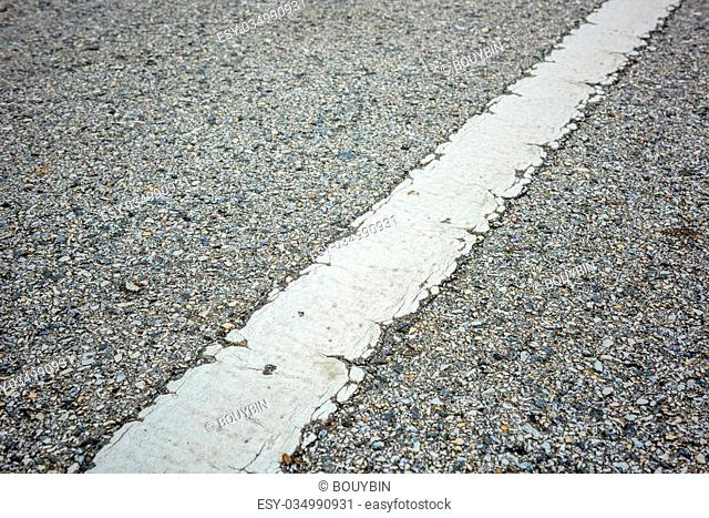 old asphalt texture with white line