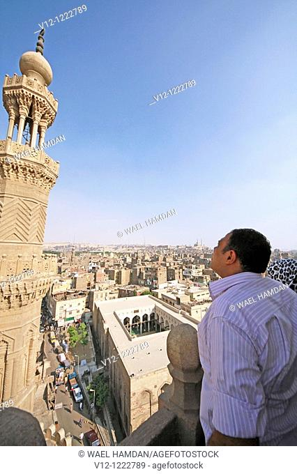 man look at The Minaret of Bab Zuweila Gate, Old Cairo, Egypt