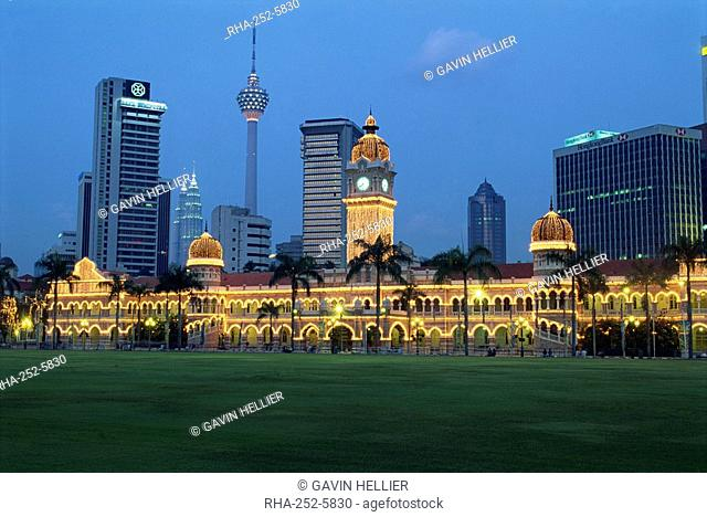 City skyline and the Sultan Abdul Samad Building illuminated at dusk, seen from Merdeka Square, Kuala Lumpur, Malaysia, Southeast Asia, Asia