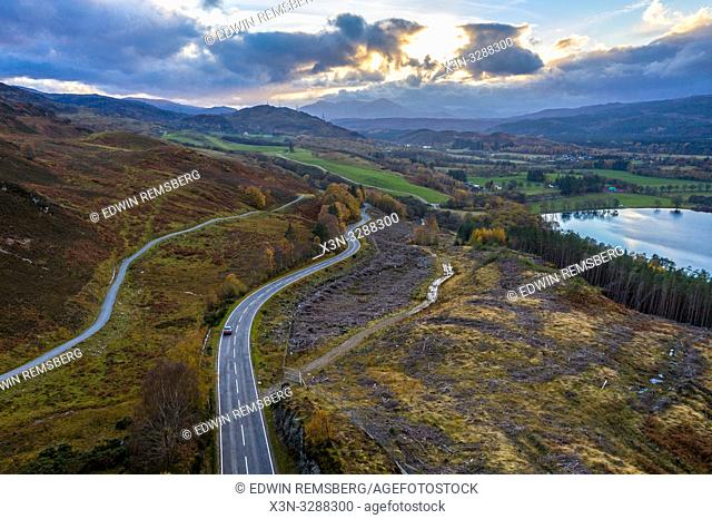 A rode cuts through the hills near Loch Ness in Scotland, United Kingdom