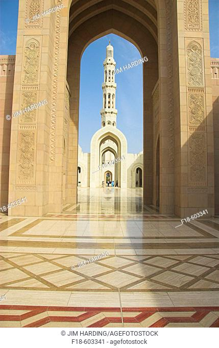 Archways and spire at the Sultan Qaboos Grand Mosque, Muscat, Oman