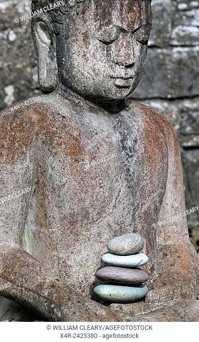 A statue of buddha in a garden in County Wesmeath, Ireland
