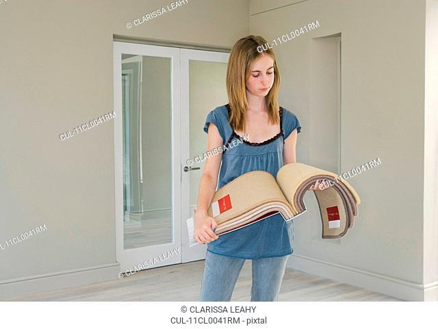 Woman looking at carpet samples