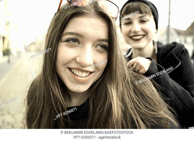 two happy women, in city Cottbus, Brandenburg, Germany