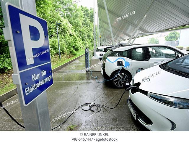 GERMANY, WUPPERTAL, 13.06.2016, DEU , GERMANY : Electric cars are being charged at a charging station of RWE / Charging cable / Charging plug / , 13