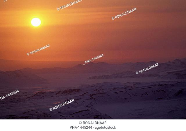 Sunset over the frozen tundra of Kamchatka, a vulcanic peninsula in the far east of Russia  This picture was taken in May when the winter still rules over...