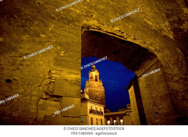 The San Bartolome church is seen through a door of the Alcazar fortress in Carmona, Seville province, Andalusia, Spain, April 20, 2011