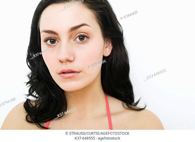Young woman looking into camera
