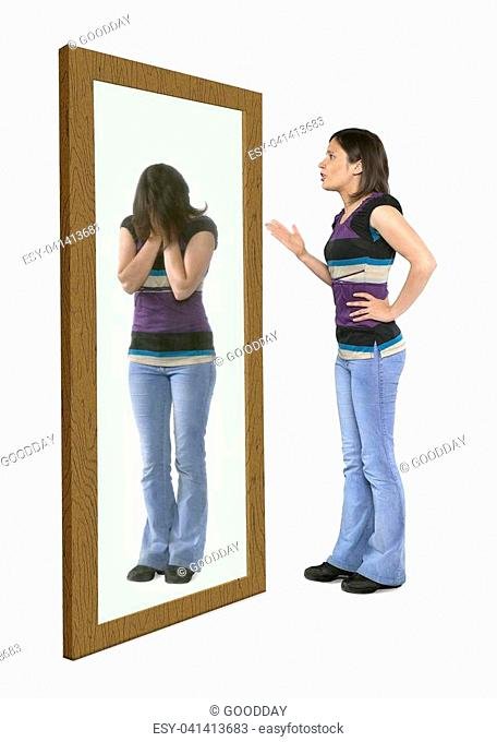 Woman scolding herself in a mirror, herreflection crying