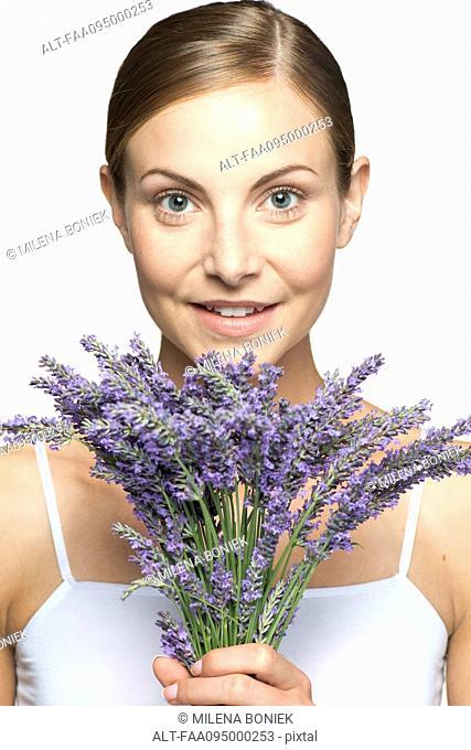 Woman holding bouquet of fresh lavender, portrait
