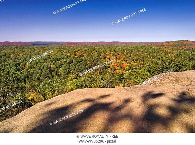 Granite bluffs with balsam fir tree shadows overlook a mixed forest, typical of the southern Canadian Shield, along the Lookout Trail in Algonquin Provincial...