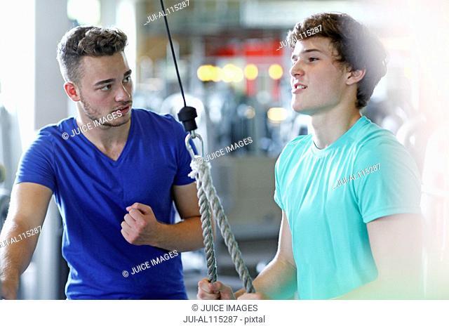 Teenage boys training in gym