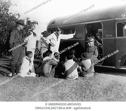 Miami Beach, Florida: c. 1925.Miami Beach Boy Scouts gather around American Boy Scout founder Dan Carter Beard on his visit to south Florida