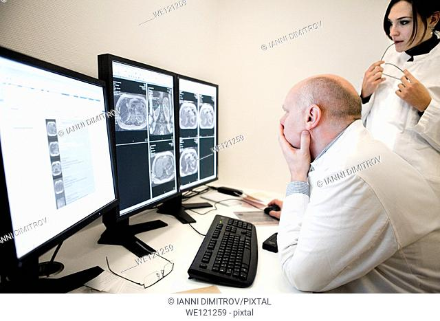 Radiologist reading MRI scans