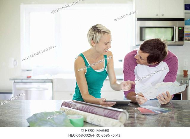mid adult couple making decorating choices