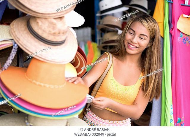 Happy teenager at a hat shop